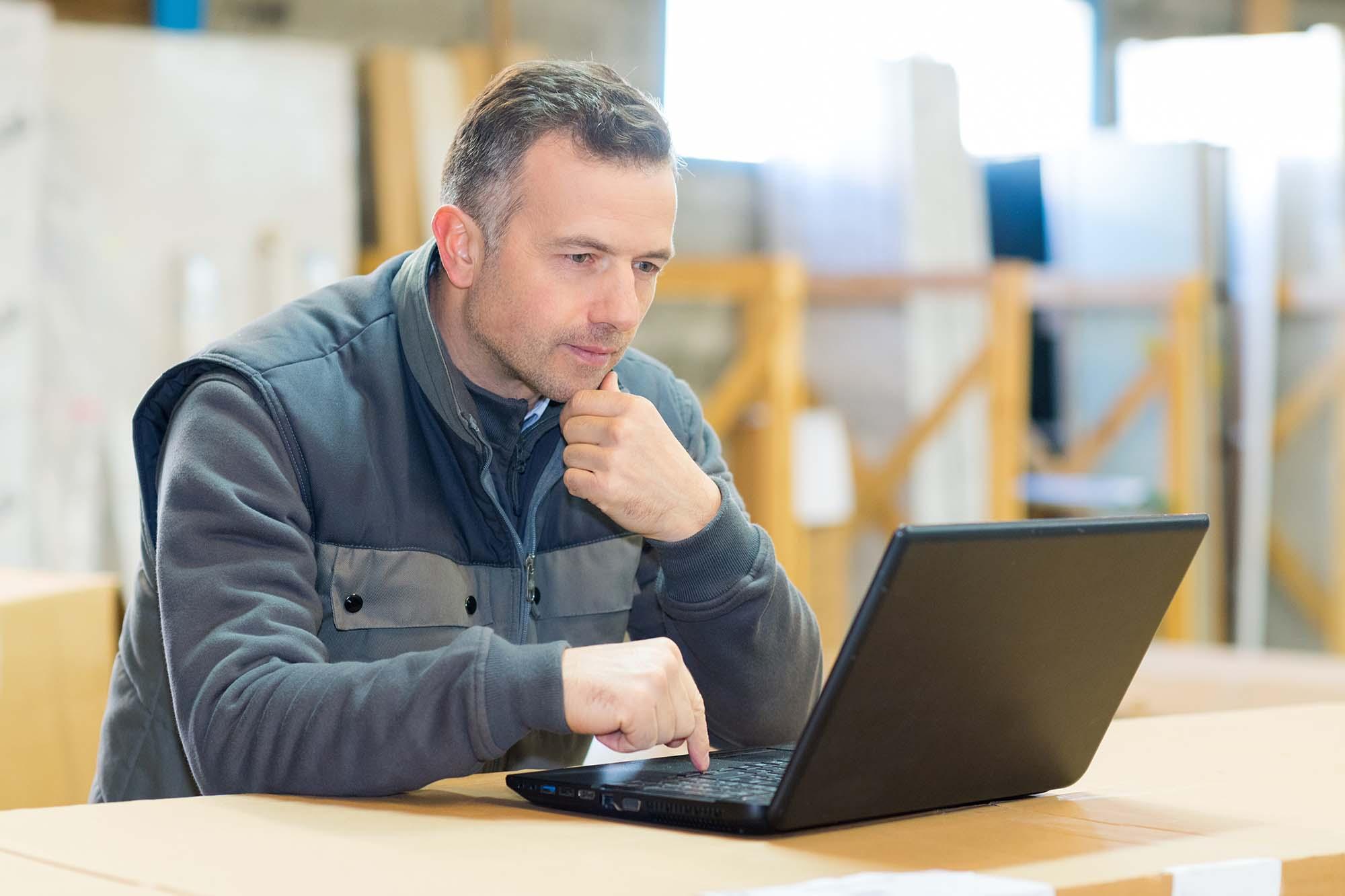 working man checking laptop